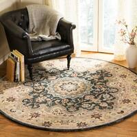 Safavieh Hand-Tufted Heritage Traditional Cream / Black Wool Rug - 6' Round