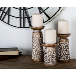 The Curated Nomad Buckroe 3-piece Rustic Mango Wood Flourish-Patterned Candle Holder Set