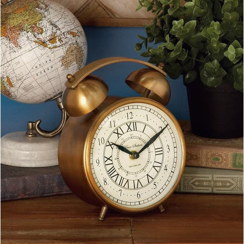 Copper Grove Star Gold Metal 7-inch Table Clock