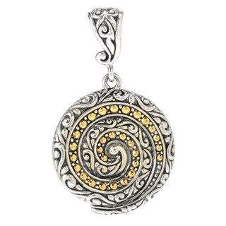 Balinese Artisan Jewelry Sterling Silver with 18K Gold round swirl pendant.