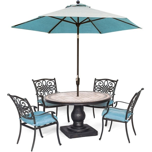 Hanover Monaco 5-Piece Dining Set in Blue with 4 Cushioned Dining Chairs, a 51-Inch Tile-Top Table, and a 9 Ft. Umbrella