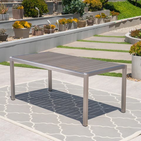 Cape Coral Outdoor Aluminum Dining Table with Faux Wood Top by Christopher Knight Home