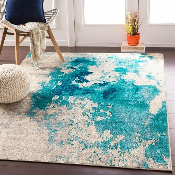 Milana Teal Abstract Area Rug. Opens flyout.
