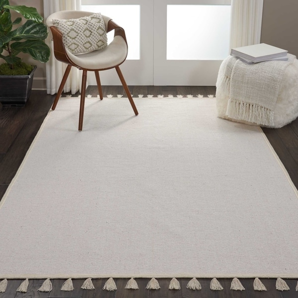 Nourison Otto Solid Tassel Area Rug. Opens flyout.