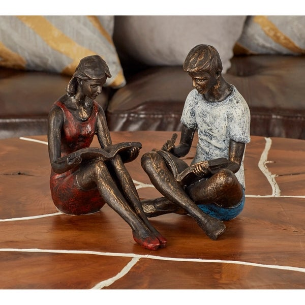 The Curated Nomad Merced Polystone Reading Boy/Girl Sculpture Pair