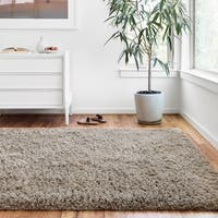 Hand-tufted Contemporary Solid Taupe Shag Area Rug - 5' x 7'6