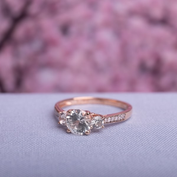 3-Stone Created White Sapphire and Diamond Engagement in 10k Rose Gold by Miadora. Opens flyout.