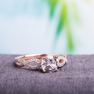 Miadora 10k Rose Gold Created White Sapphire 1/10ct TDW Diamond Infinity Engagement Ring