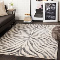 "Niamey Black & Beige Animal Print Area Rug - 7'10"" x 10'3"""