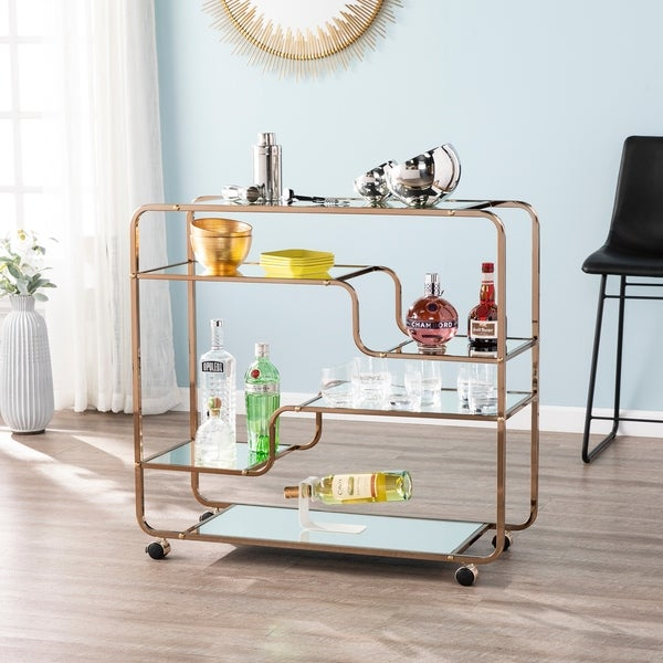 Carson Carrington Stovring Champagne Gold Mirrored Bar Cart. Opens flyout.