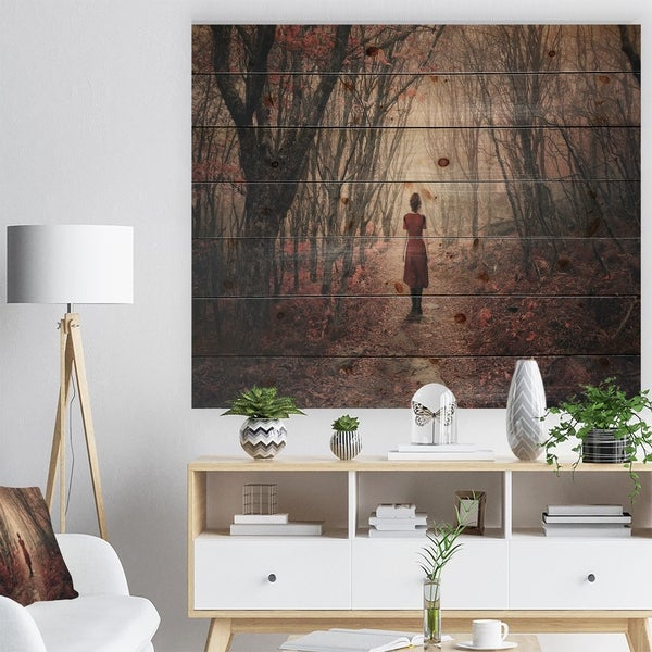 Designart 'Woman in Frosty Forest' Landscape Photography Print on Natural Pine Wood - Red