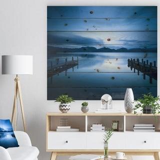 Designart 'Dark Blue Sea and Piers' Seascape Print on Natural Pine Wood
