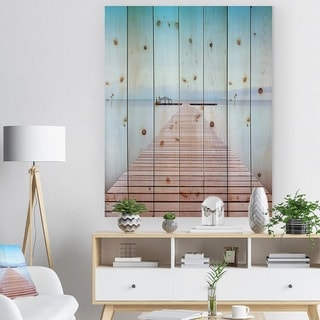 Designart 'Wooden Pier in Cold Atmosphere' Seascape Print on Natural Pine Wood - Multi-color