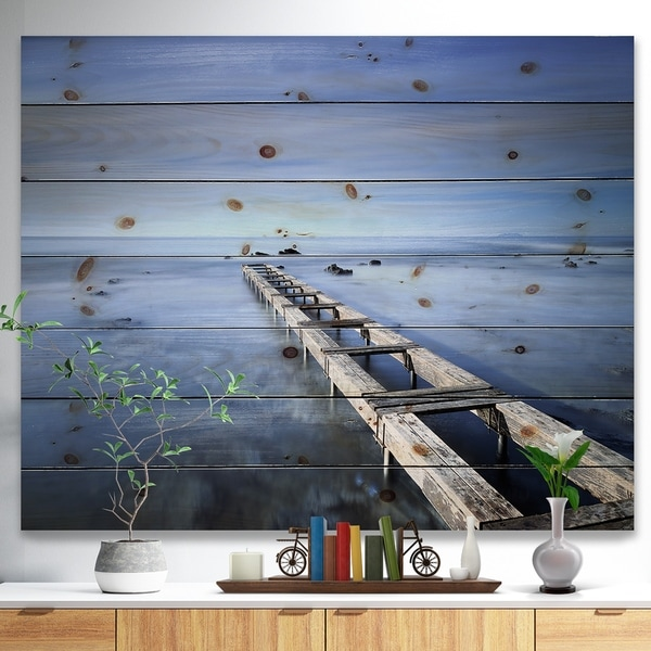 Designart 'Dark Blue Sky and Large Pier' Seascape Print on Natural Pine Wood