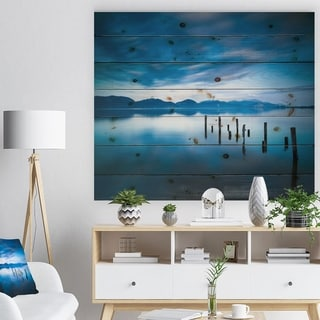 Designart 'Blue Lake with Wooden Pier' Landscape Photography Print on Natural Pine Wood - Blue