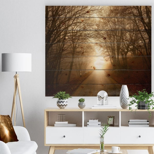 Designart 'Path to Sunlight in Autumn Forest' Landscape Photography Print on Natural Pine Wood - Brown