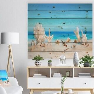 Designart 'Seashells on Tropical Beach' Seashore Photo Print on Natural Pine Wood - Blue