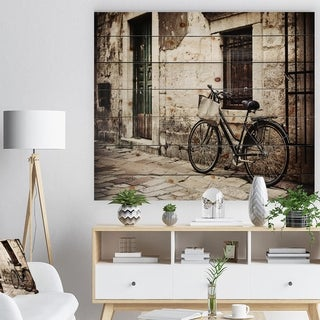 Designart 'Bicycle with Shopping Bag' Landscape Photo Print on Natural Pine Wood - Black