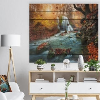 Designart 'Fast Flowing Fall River in Forest' Landscape Photography Print on Natural Pine Wood - Blue