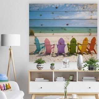 Designart 'Adirondack Beach Chairs' Seashore Photo Print on Natural Pine Wood - Blue