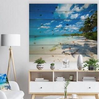 Designart 'Tropical Beach with Palm Shadows' Seashore Print on Natural Pine Wood - Blue