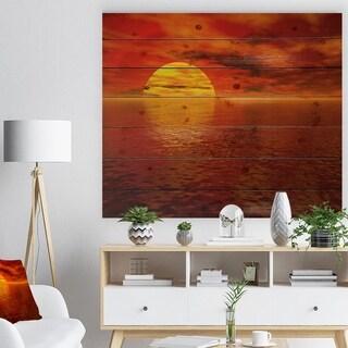 Designart 'Sun Falling to Yellow Ocean' Seashore Print on Natural Pine Wood - Red