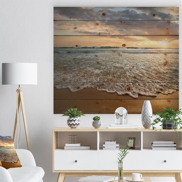 Designart 'Bright Cloudy Sunset in Calm Ocean' Seashore Print on Natural Pine Wood - Blue