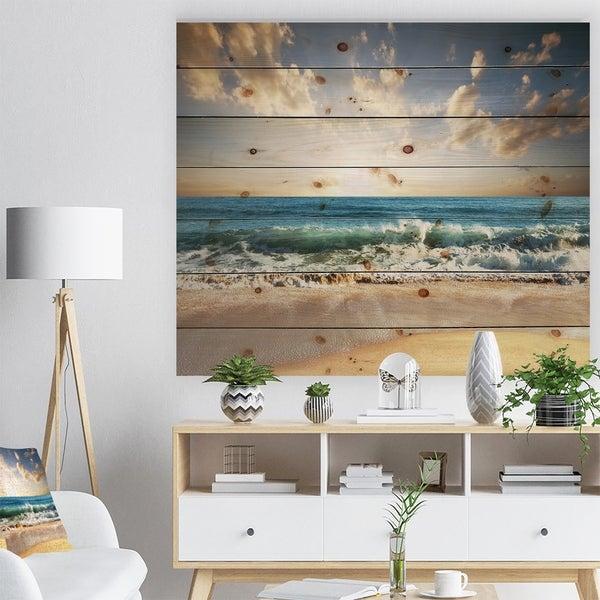 Designart 'Cloudy Sky and Vibrant Blue Sea' Seascape Print on Natural Pine Wood