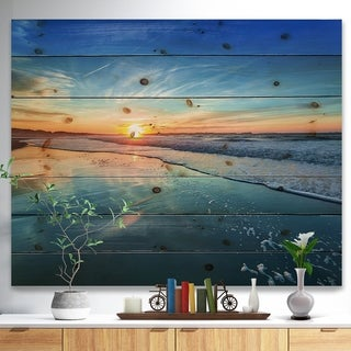 Designart 'Blue Seashore with Distant Sunset' Seascape Print on Natural Pine Wood - Blue