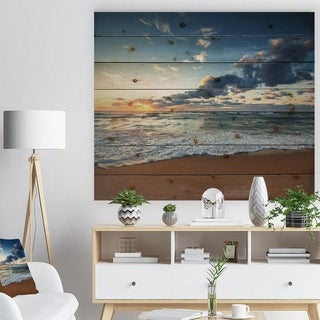 Designart 'Sunrise and Glowing Waves in Ocean' Seascape Print on Natural Pine Wood - Blue