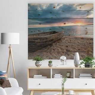 Designart 'Rusty Row Boat on Sand at Sunset' Seascape Print on Natural Pine Wood - Multi-color