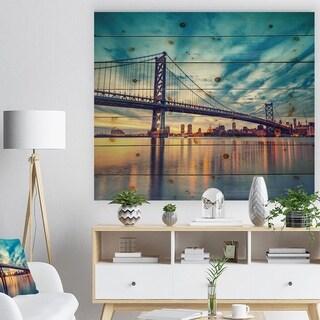 Designart 'Ben Franklin Bridge in Philadelphia' Cityscape Print on Natural Pine Wood - Multi-color