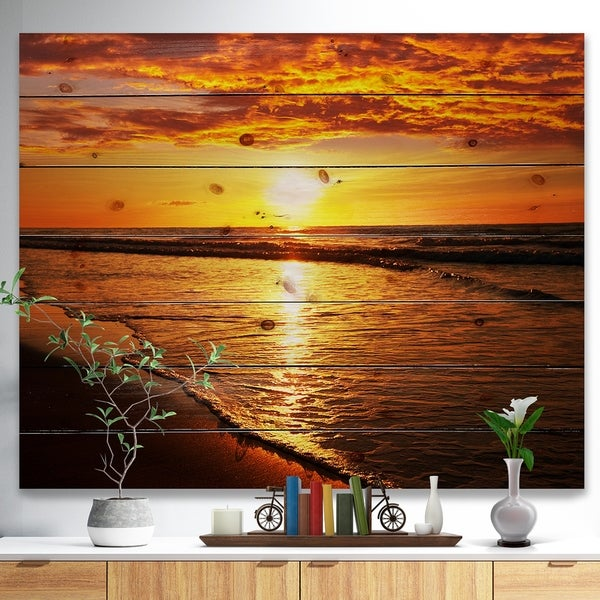 Designart 'Bright Yellow Sunset over Waves' Modern Beach Print on Natural Pine Wood