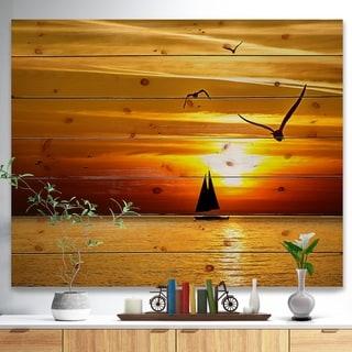 Designart 'Bright Yellow Beach with Birds' Seashore Print on Natural Pine Wood - Blue
