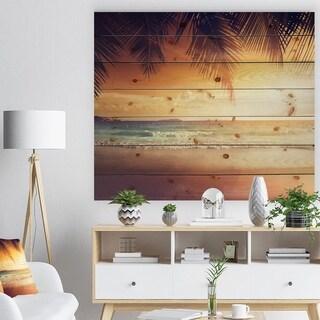 Designart 'Palm Leaves on Caribbean Seashore' Modern Seashore Print on Natural Pine Wood - Red