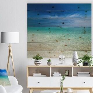 Designart 'Turquoise Ocean Under Blue Sky' Modern Seascape Print on Natural Pine Wood