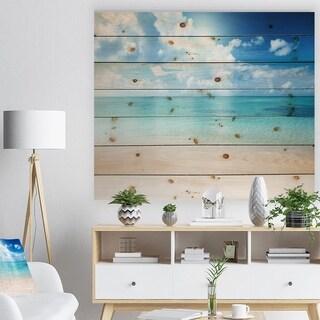 Designart 'Sand of Beach in Blue Caribbean Sea' Modern Seascape Print on Natural Pine Wood