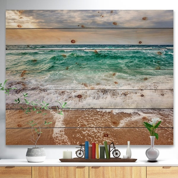 Designart 'Crystal Clear Blue Foaming Waves' Seascape Print on Natural Pine Wood - Green
