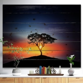 Designart 'Beautiful Sunset over Lonely Tree' Landscape Print on Natural Pine Wood - Multi-color