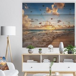 Designart 'Sunrise on Beach of Caribbean Sea' Seashore Print on Natural Pine Wood - Blue