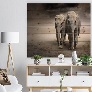 Designart 'Elephant Pair in Motion' Animal Print on Natural Pine Wood - Grey