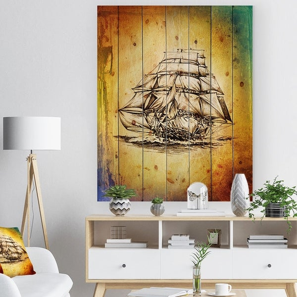 Designart 'Colorful Old Moving Boat Drawing' Seashore Print on Natural Pine Wood - Multi-color