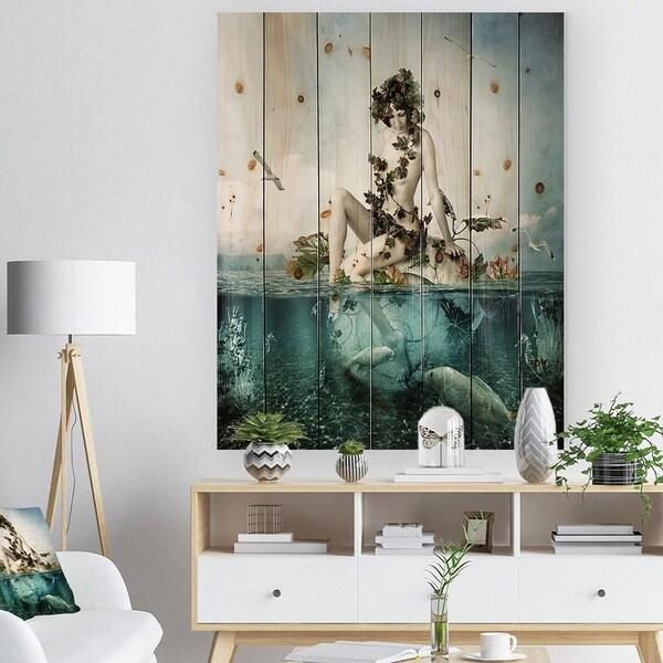 Designart 'Woman Seating on Shell' Modern Sea & Shore Print on Natural Pine Wood - Blue