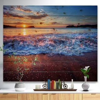 Designart 'Blue Sea Waves during Sunset' Seashore Print on Natural Pine Wood - Blue