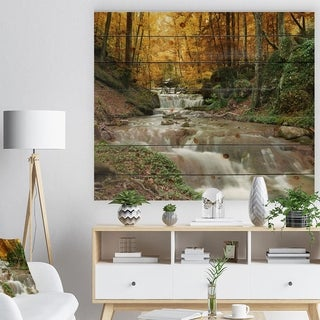 Designart 'Forest Waterfall with Yellow Trees' Landscape Print on Natural Pine Wood