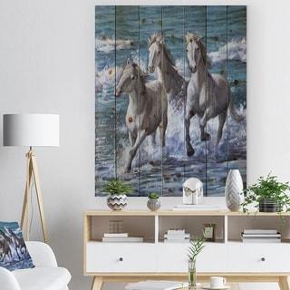 Designart 'Three Horses Running in Seaside' Farmhouse Animal Painting Print on Natural Pine Wood - Blue