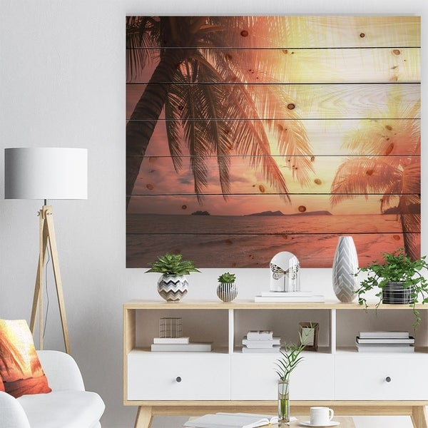 Designart 'Coconut in Golden Sunset' Landscapes Sea & Shore Photographic Print on Natural Pine Wood - Brown