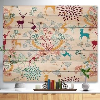 Designart 'Yellow Blue Brown Reindeer christmas pattern' Print on Natural Pine Wood