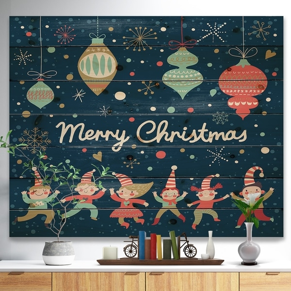 Designart 'Merry Christmas Dancing Elf Children and Snow Flakes' Print on Natural Pine Wood - Blue