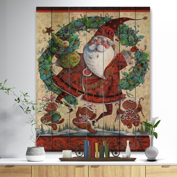 Designart 'Frolic Santa with Gingerbread Men and Wreathe' Print on Natural Pine Wood - Red